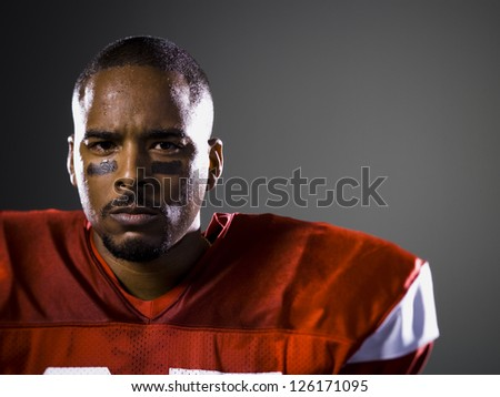 Portrait of African American football player - stock photo