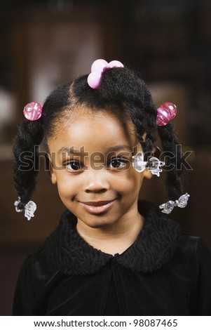 Portrait of African American girl with ponytails - stock photo