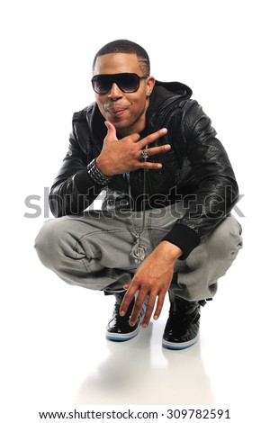 Portrait of African American hip hop artist isolated over white background - stock photo