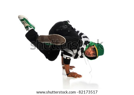 Portrait of African American hip hop dancer balancing on hands isolated over white background - stock photo