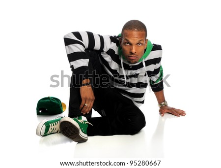 Portrait of African American hip hop man sitting isolated over white background - stock photo