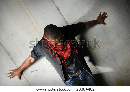 Portrait of African American hip hop man with arms spread