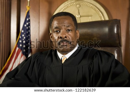 Portrait of African American judge sitting in courtroom