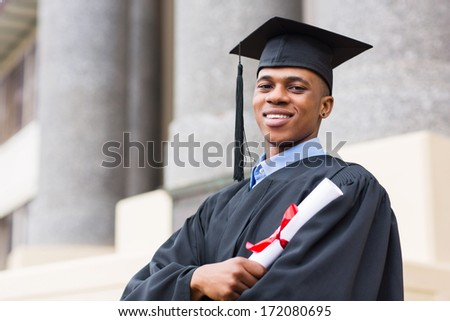 portrait of african american male graduate standing outside college - stock photo