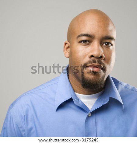 Portrait of African American man against gray background.