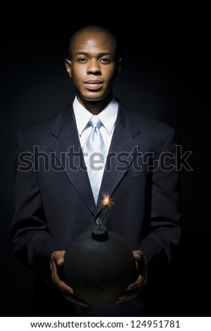 Portrait of African American man holding bomb - stock photo