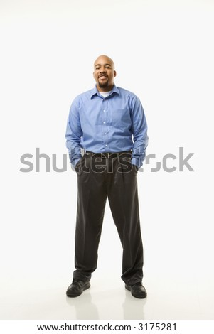 Portrait of African American man standing against white background.