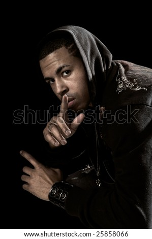 Portrait of African American man with hood over a black background - stock photo