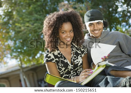 Portrait of African American students studying on college campus - stock photo