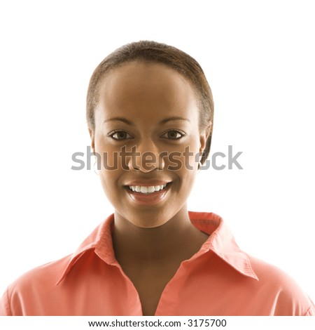 Portrait of African American woman smiling against white background.
