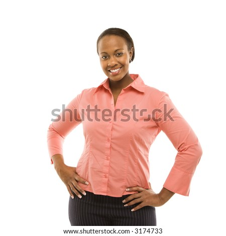 Portrait of African American woman standing smiling against white background.