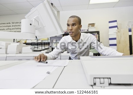 Portrait of African American working on printing factory - stock photo