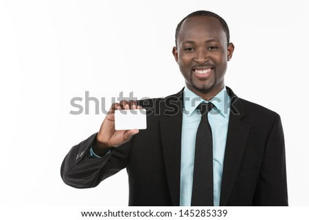 Portrait of African Businessman with blank business card - stock photo
