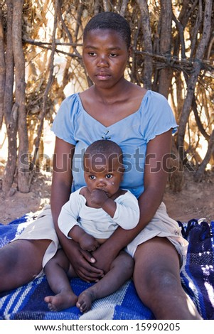 Portrait of African child and mother in the hut, location Mmankodi village, Botswana - stock photo