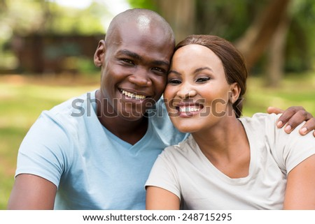 portrait of african couple sitting outdoors