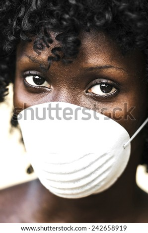 Portrait of African Doctor Curing Symbol (Virus Outbreak) with a mask (protective help) - stock photo