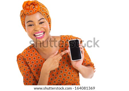 portrait of african girl pointing at smart phone on white background - stock photo