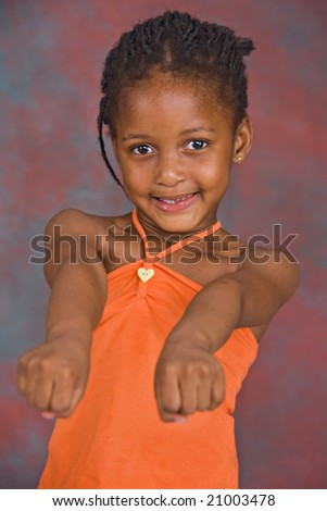 portrait of african girl with orange blouse - stock photo