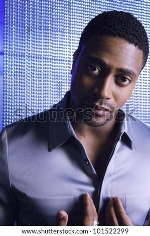 Portrait of African man pointing at chest - stock photo
