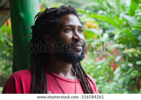 Portrait of African man with dreadlocks - stock photo