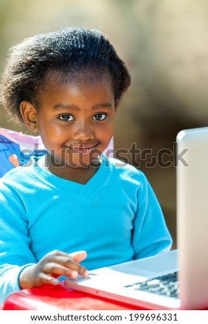 Portrait of African student navigating on laptop. - stock photo