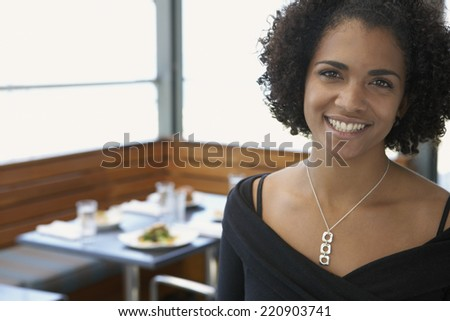 Portrait of African woman in restaurant - stock photo