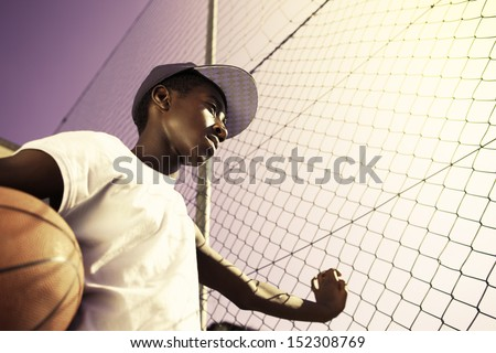Portrait of afro-american boy with basketball - stock photo