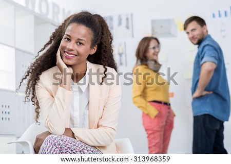 Portrait of afroamerican female trainee in creative company - stock photo