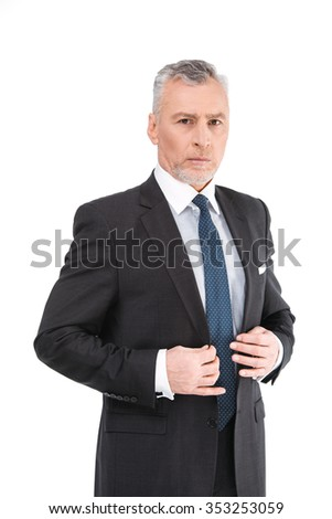 Portrait of aged businessman wearing suit and tie. Businessman in years standing on white background. Boss looking at camera