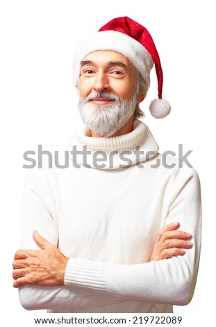 Portrait of aged kind barbate man with a Santa's hat on his head and his hands folded - stock photo