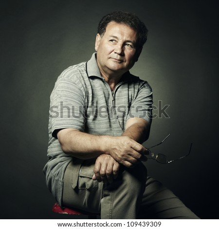 Portrait of aged man close up. Studio photo - stock photo