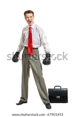 Portrait of aggressive businessman in boxing gloves over white background - stock photo