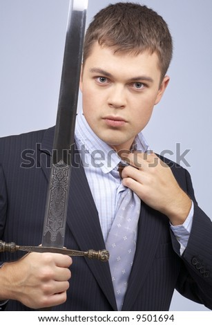 portrait of aggressive corporate worker with sword - stock photo