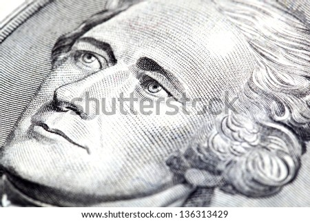 Portrait of Alexander Hamilton in front of the five dollar bill - stock photo