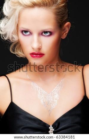 portrait of alluring blonde over black background - stock photo