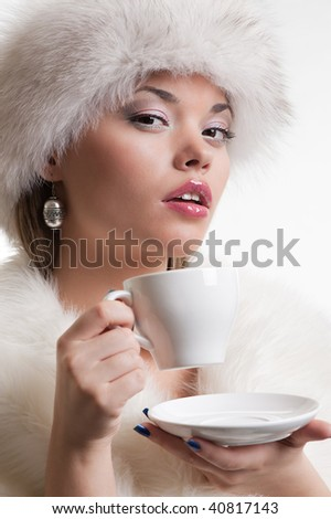 portrait of alluring woman with cup of coffee - stock photo