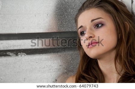 Portrait of alone young urban girl. - stock photo