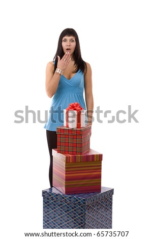 Portrait of amazed girl with gift boxes. isolated on white background