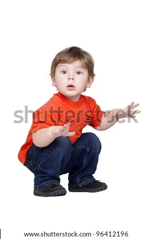 Portrait of amazed little boy in a red shirt over white background. - stock photo