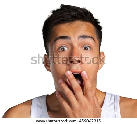 portrait of amazed man covering his mouth