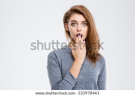 Portrait of amazed woman covering her mouth with palm isolated on a white background - stock photo