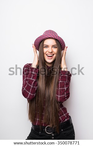 Portrait of amazed woman looking at camera - stock photo