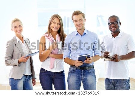 Portrait of ambitious business people smiling positively at the viewer