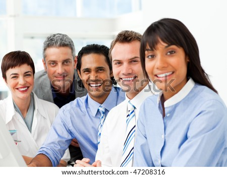 Portrait of ambitious business team at work in the office - stock photo