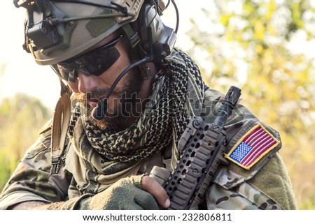 Portrait of American Soldier looking down - stock photo
