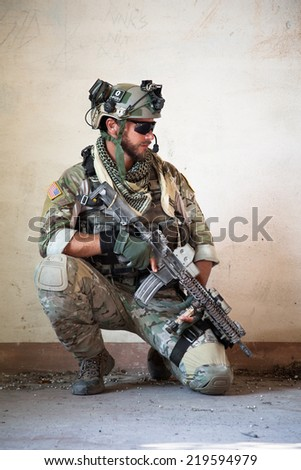 Portrait of american soldier resting from military operation  - stock photo