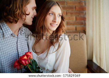 Portrait of amorous young man embracing his sweetheart - stock photo
