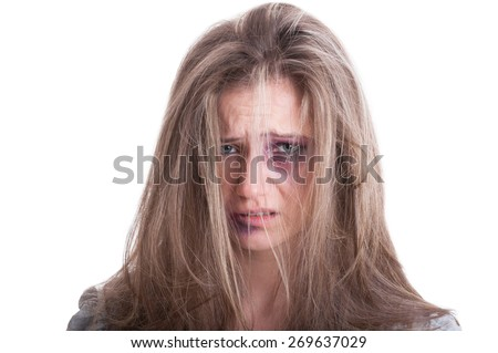 Portrait of an abused woman victim of domestic violence isolated on white background - stock photo