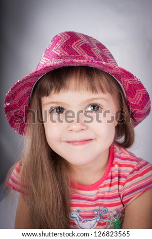 Portrait of an adorable baby girl in pink hat.