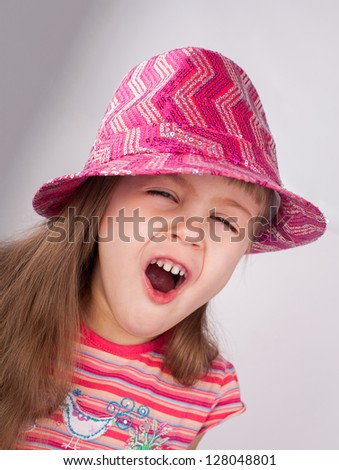 Portrait of an adorable baby girl in pink hat. - stock photo
